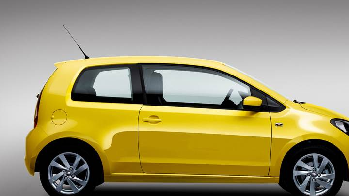 Side Pose Of 2012 SEAT Mii In Yellow